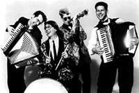 """Duel accordions a-blazing, Jimmy """"The Doo"""" Jackson's horn-like thing calling the cows home, and """"Smilin'"""" Eddie's steady beats never ceased to get party rockin'."""